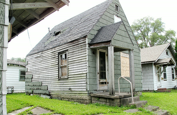 Stu Hirsch | For The Herald Bulletin<br /> This house at 213 W. 22nd Street in Anderson, and the one in the<br /> background are among more than 70 abandoned homes the city plans to<br /> demolish with $1.4 million in federal money it received.