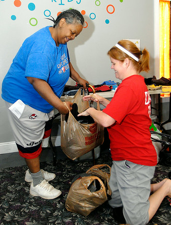John P. Cleary | The Herald Bulletin<br /> Lisa Nevins, right, helps bag up clothing items for Nancy Turner who picked  them out from Greater Light Church's clothes closet during their Greater Light Gives Back event Saturday.  To view or buy this photo and other Herald Bulletin photos, visit<br /> photos.heraldbulletin.com.
