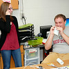 0007-08: Elwood Elementary School teachers Jenna Knapp, left, and Caleb<br /> Evans discuss the beginning of school Thursday. Knapp is a special<br /> education teacher and Evans is part of the pre-school staff.