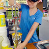John P. Cleary | The Herald Bulletin<br /> Mikayla Cumings puts the squeeze on these fresh lemons as she makes a Lemon Shake-up at the families' concession stand Monday at the Madison County 4-H Fair.
