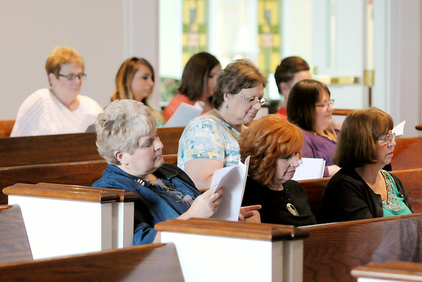 Don Knight | The Herald Bulletin<br /> Teachers read from a prayer book during Anderson First Baptist Church's Back to School Teacher Blessing on Saturday. To view or buy this photo and other Herald Bulletin photos, visit photos.heraldbulletin.com.