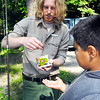 John P. Cleary | The Herald Bulletin<br /> Aaron Douglass, interpretive naturalist for Mounds State Park, passes out fishing bait to junior naturalists before going fishing.