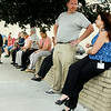 John P. Cleary   The Herald Bulletin<br /> Madison County Government Center employees wait along Meridian Street after being evacuated from the building do to a bomb threat Monday afternoon.