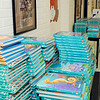 0011: Just add students. Reading books are stacked in a hall at Elwood<br /> Elementary School awaiting distribution to kids. School begins today in<br /> Elwood.