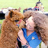Don Knight | The Herald Bulletin<br /> Debra Schneider from Little bit of Heaven Farm kisses her alpaca Flash during the People and Pets Extravaganza at New Horizons United Methodist Church on Saturday. When Flash was rejected by his mother Schneider brought him into her home and bottle fed him. To view or buy this photo and other Herald Bulletin photos, visit photos.heraldbulletin.com.