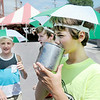 "Don Knight | The Herald Bulletin<br /> Dane Busch sips on a mug of root beer as he walks past vendors with from left, Tristan Hunt and Gavin ""Sparky"" Manis during the Lapel Village Fair on Friday."
