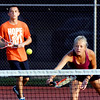 John P. Cleary | The Herald Bulletin<br /> Sidnay Huck returns the ball as her partner Matt Tran moves over to back her up during their mixed A doubles match Friday evening at the Anderson Tennis Classic.