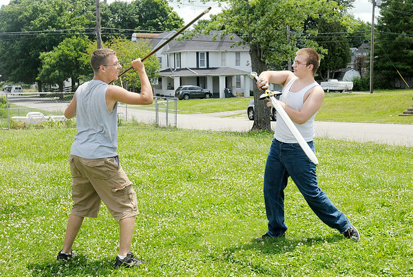 Don Knight | The Herald Bulletin<br /> Cody Phillips, left, and Drake Harris spar with a staff and foam sword in Alexandria on Wednesday. Phillips and Harris said sparring improves their hand eye coordination as well as focuses their mind. To view or buy this photo and other Herald Bulletin photos, visit photos.heraldbulletin.com.