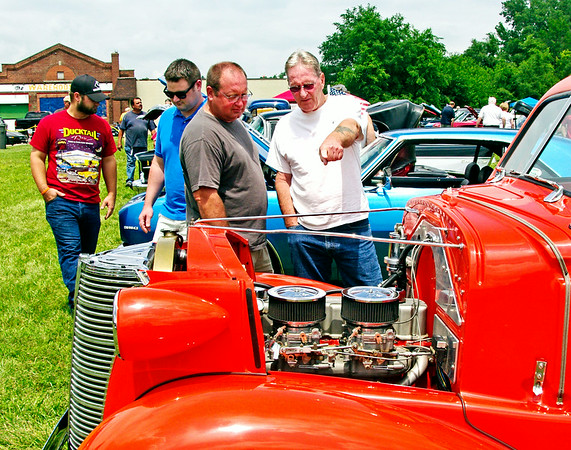 Mark Maynard  | for The Herald Bulletin<br /> Mark Gerrard and his father, Don Garrard, of Muncie check out the engine in a custom car during the 12th Annual Bill Vaughn Memorial Cruise-In at Frisch's on Saturday.