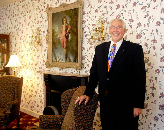 John P. Cleary | The Herald Bulletin<br /> Scott Wilkins, at his post by the front door greeting visitors, is retiring from Rozelle-Johnson Funeral Service after 50 years as a funeral director.
