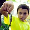 John P. Cleary | The Herald Bulletin<br /> Mounds State Park's junior naturalists day camp participant Conner Isaacs, 10, shows off the fish he caught before  putting it back in White River.