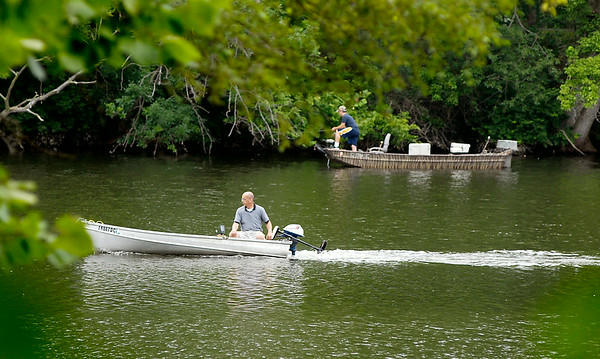 John P. Cleary | The Herald Bulletin<br /> Intermittent rain didn't stop the anglers from getting out in their boats on Shadyside Lake to try their luck. To view or buy this photo and other Herald Bulletin photos, visit<br /> photos.heraldbulletin.com.