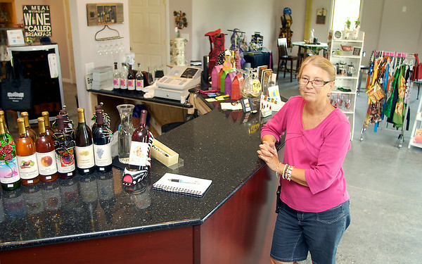 John P. Cleary | The Herald Bulletin<br /> Cathy Hensley of Madison County Winery in their new location at 10942 South 400 East, Markleville.