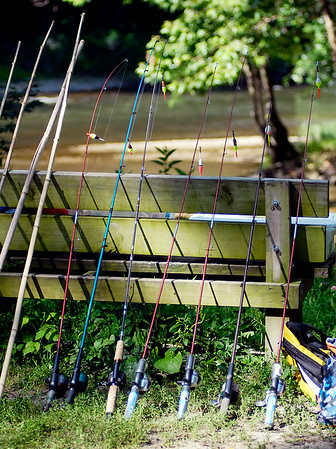 John P. Cleary | The Herald Bulletin<br /> An array of fishing poles are lined up waiting the Junior Naturalists Day Camp kids at Mounds State Park.