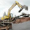 Don Knight | The Herald Bulletin<br /> A backhoe sorts through the remains of three buildings in the 100 block of Harrison street in downtown Alexandria on Wednesday. The historic buildings had become unsafe.