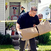 John P. Cleary | The Herald Bulletin<br /> Elwood police remove evidence Wednesday morning from a home in the 1800 block of North C Street in Elwood as they investigate the death of Linda Speer, 66. Police said the death was suspicious.