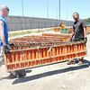 Don Knight | The Herald Bulletin<br /> A crew from American Fireworks Company begins the work of setting up for the fireworks show at Hoosier Park on Friday. From left are Zach Bowyer, Joey Walden and Leif Johansen.