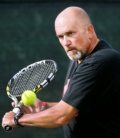 John P. Cleary | The Herald Bulletin<br /> David Ellis hits a backhand during his Men's A Singles match against Cameron Scott Wednesday evening in the Anderson Tennis Classic.