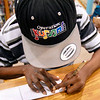 John P. Cleary | The Herald Bulletin<br /> As Deon Parsons works in the Anderson Public Library the young cartoonist wears a hat with his cartoon's name on it.