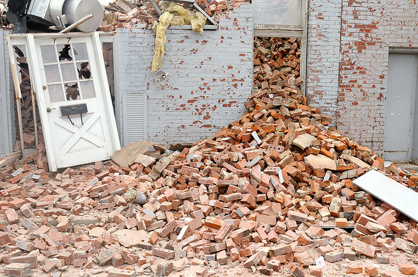 Don Knight | The Herald Bulletin<br /> Bricks spill out of a doorway of a historic building demolished in downtown Alexandria on Wednesday.  To view or buy this photo and other Herald Bulletin photos, visit photos.heraldbulletin.com.