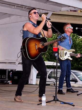 """Madison County's own Corey Cox performs """"Good Night Comin' On"""" to open his concert at the City of Anderson's belated Indepence Day Celebration on Sunday evening."""