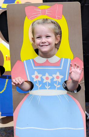 Don Knight | The Herald Bulletin<br /> Jade Wensel, 5, poses for a picture in a Goldilocks cut out during meet the teacher night at the Killbuck Kindergarten Extension on Tuesday. Anderson students return to the classroom on Wednesday August 3rd.