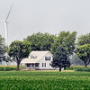 John P. Cleary | The Herald Bulletin<br /> These Wildcat Wind Farm turbines surround the back of this home in Madison County on CR 1500 North just west of CR 800 West outside of Elwood.