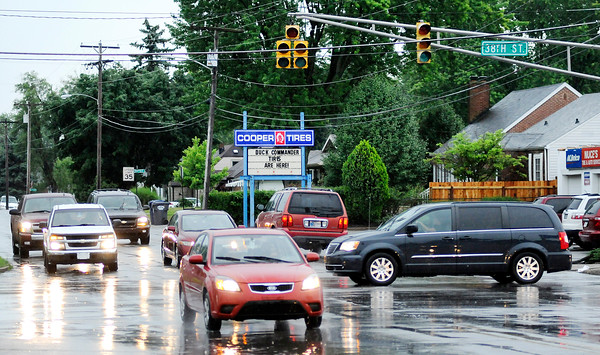 Don Knight   The Herald Bulletin<br /> Motorists negotiate the intersection at 38th and Main Streets after a thunderstorm knocked out power to the stop lights on Wednesday.