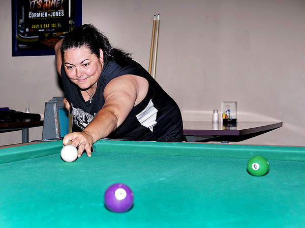 Mark Maynard | for The Herald Bulletin<br /> Shawn Whitehead of Anderson's Money Shots 9-ball team lines up on the cue ball during practice for the up-coming national billiards competition in Las Vegas.