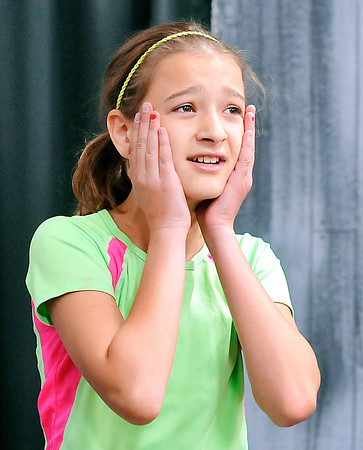 """John P. Cleary   The Herald Bulletin<br /> Lilly Thomas, 11, who plays Cinderella, sings her song during rehearsals for the upcoming youth production of """"Cinderella"""" at Commons Theatre in Alexandria."""