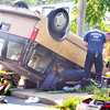 John P. Cleary | The Herald Bulletin<br /> Anderson firefighters work to extract the driver of this overturned van after being involved in a two vehicle accident at Cincinnati Ave and Ohio Ave. in Anderson.