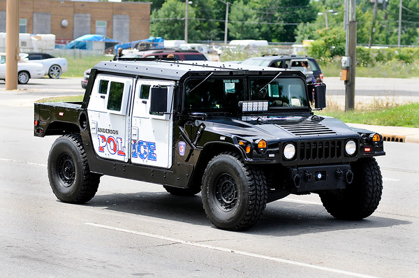 Don Knight   The Herald Bulletin<br /> Anderson Police Department's Community Policing division officer Brett Webb drives the departments armored humvee in the Anderson Black Expo parade earlier this month.