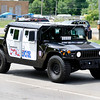 Don Knight | The Herald Bulletin<br /> Anderson Police Department's Community Policing division officer Brett Webb drives the departments armored humvee in the Anderson Black Expo parade earlier this month.