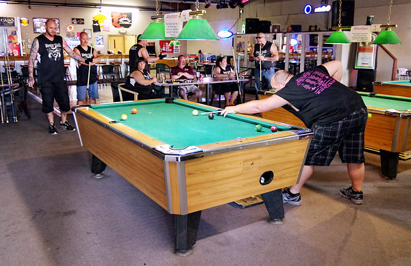 Mark Maynard | for The Herald Bulletin<br /> The Bourbon Street Bar & Grill in Anderson is where the Money Shots and other 9-ball players gather to hone their billiard skills.