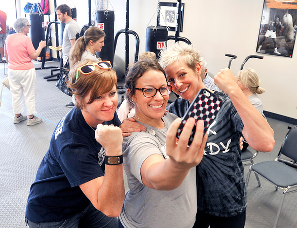 John P. Cleary | The Herald Bulletin<br /> Rock Steady Boxing coaches Kristy Rose-Follmar, Robin Ranaphyali, and Chris Timberlake take a selfie during the open house Thursday afternoon for the new facility. Community Hospital Anderson is affiliated with Rock Steady Boxing in opening this Anderson location at 182 West 300 North in which they specialize in a rehabilitation boxing program for Parkinson patients.