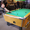 Mark Maynard | for The Herald Bulletin<br /> Money Shots team member Nick Rennier lines up his shot during a game of 9-ball while preparing for the team's return to Las Vegas.