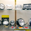 John P. Cleary | The Herald Bulletin<br /> An assortment of headlights that are on display at the Guide Lamp exhibit at  the Madison County Historical Society.