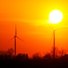 File photo | The Herald Bulletin<br /> The sun sets over the Wildcat wind farm north of Elwood in this file photo from 2012.