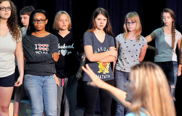 """John P. Cleary   The Herald Bulletin<br /> Cast members of Mainstage Theatre's youth production of """"Aladdin Jr."""" listen to directions as they go through rehearsal."""