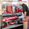 John P. Cleary | The Herald Bulletin<br /> Harry Kirchenbauer looks over the different taillight assemblies on display at the Guide Lamp exhibit at the Madison County Historical Society. Kirchenbauer was an engineer for the company for more then 30 years.