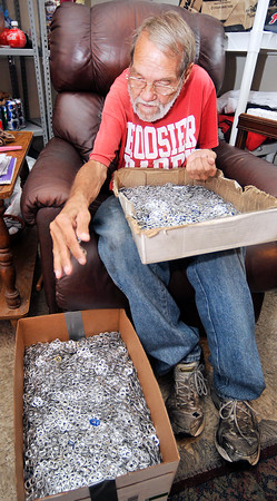 John P. Cleary | The Herald Bulletin<br /> Larry VanNess counting tabs working toward his 12th millionth tab donated to the Ronald McDonald House.