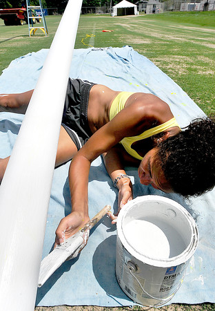 John P. Cleary   The Herald Bulletin<br /> Anderson University senior Victoria Smith puts a primer coat of paint on the south goal post at the Colts practice field Tuesday afternoon in preparation for the start of training camp next week. Smith, who works for the Colts maintenance department, said she will finish up with a bright new coat of yellow paint for the posts.