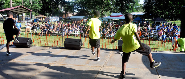 John P. Cleary   The Herald Bulletin<br /> UIB perform their dance routine during the Youth Talent Showcase at the kickoff of Anderson Black Expo Friday evening at Jackson Park.