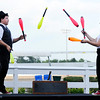 Don Knight | The Herald Bulletin<br /> From left, Alban Schneider and Katy Jane Harrington with the Cincinnati Circus Company juggle as the entertain the crowd between the races at Hoosier Park on Saturday.