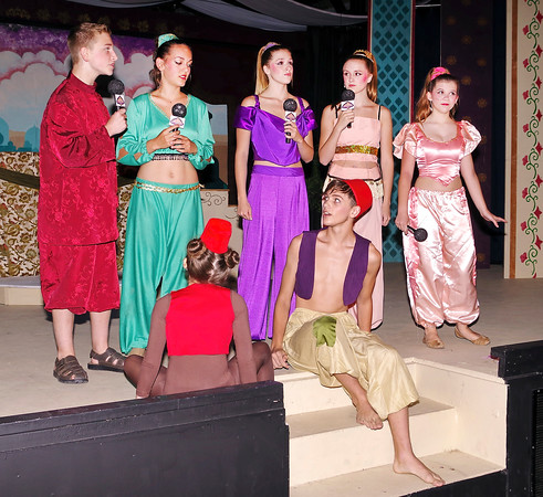 "Mark Maynard   for The Herald Bulletin<br /> Narrators Aiden Ebbert, Alana Weber, Jaden Precup, Macin Precup and Hannah Stockwell confront Aladdin (Parker Smith) and Abu the monkey (Madison Scott) in ""Aladdin Jr."""