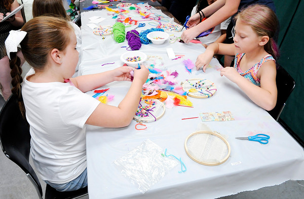 Don Knight   The Herald Bulletin<br /> From left, Ella Lehr and Delaney Hudson pick out feathers for their dream catchers during a Girls Art Camp at the Anderson Center for the Arts' on Thursday.