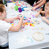 Don Knight | The Herald Bulletin<br /> From left, Ella Lehr and Delaney Hudson pick out feathers for their dream catchers during a Girls Art Camp at the Anderson Center for the Arts' on Thursday.