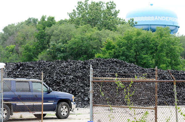 Don Knight   The Herald Bulletin<br /> Large piles of shredded tires can be seen on the property of Green Tire Reclamation in Anderson. The business was founded with the intention of recycling the shredded tires but has been unable to find a buyer.