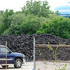 Don Knight | The Herald Bulletin<br /> Large piles of shredded tires can be seen on the property of Green Tire Reclamation in Anderson. The business was founded with the intention of recycling the shredded tires but has been unable to find a buyer.