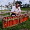 "Sam Probst of ""Sky Magic"" connects shell fuses together in preparation for Anderson's belated Fourth of July fireworks show on Sunday evening."